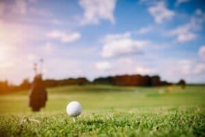White golf ball on a green grass